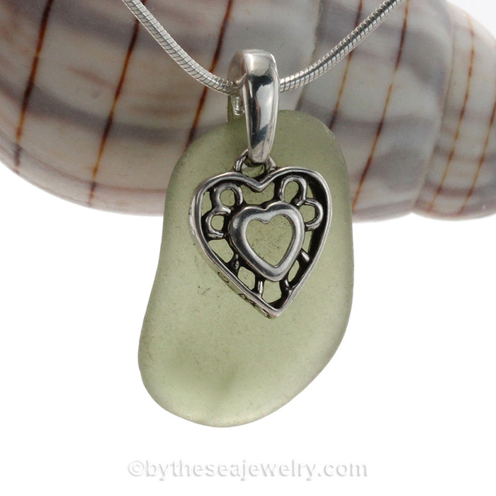 Soft Seaweed Green genuine sea glass with a solid sterling bail and detailed heart in hearts charm.