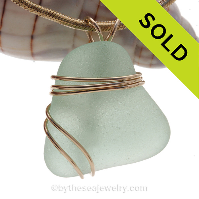 Perfect piece of lovely squarish seafoam green sea glass in our triple rolled gold setting.