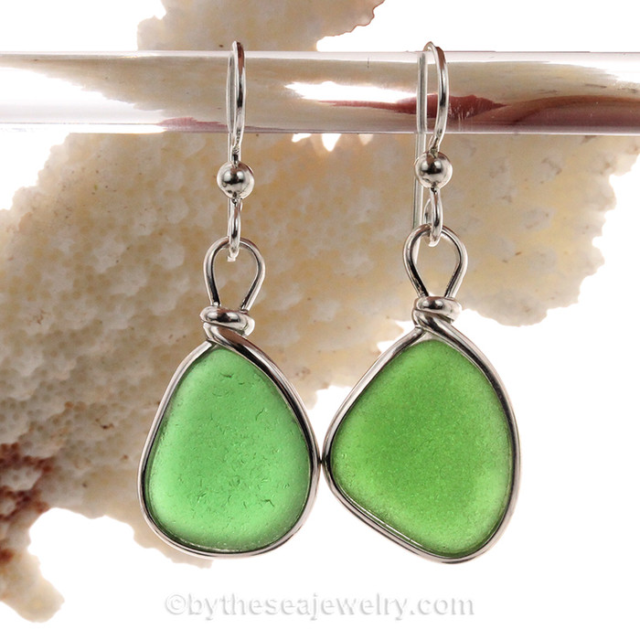 PERFECT Genuine beach found Bright Green Sea Glass Earrings in a Solid Sterling Silver Original Wire Bezel© setting. This is a perfect sea glass in a natural state, just the way it was found on the beach!  Our Original version and leaves both front and back open without destroying the integrity of the sea glass.