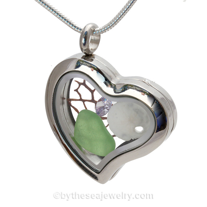 Simple and lovely green beach found Sea Glass combined a silver Heart Locket necklace with Sandollar , vintage seafan bit and a diamond like Crystal Gems