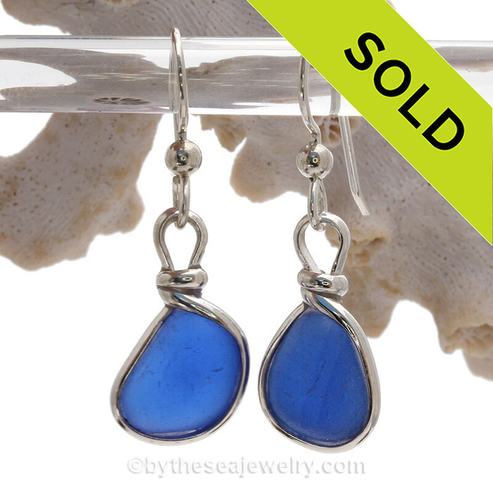 Smaller Cobalt Blue Genuine Sea Glass gems set in our Original Wire Bezel in Sterling.