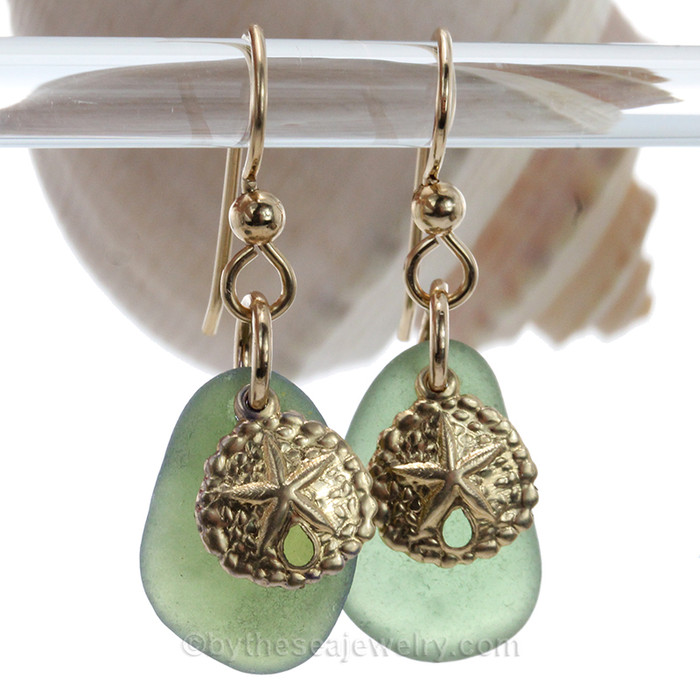 Genuine seaweed green sea glass pieces are set with 14K Goldfilled Sandollar charms on professional grade earring wires.