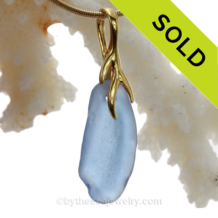 A soft lovely piece Carolina Blue sea glass on a nautical 24K gold Vermeil (gold on silver) necklace.