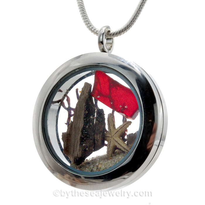 REAL Ruby Red  sea glass combined with a small starfish in this stainless steel locket necklace. A cool small piece of drift wood, make this a perfect beach scene. a great gift idea for anyone with a July Birthday or a beach lover yearning for that elusive e piece of red sea glass.