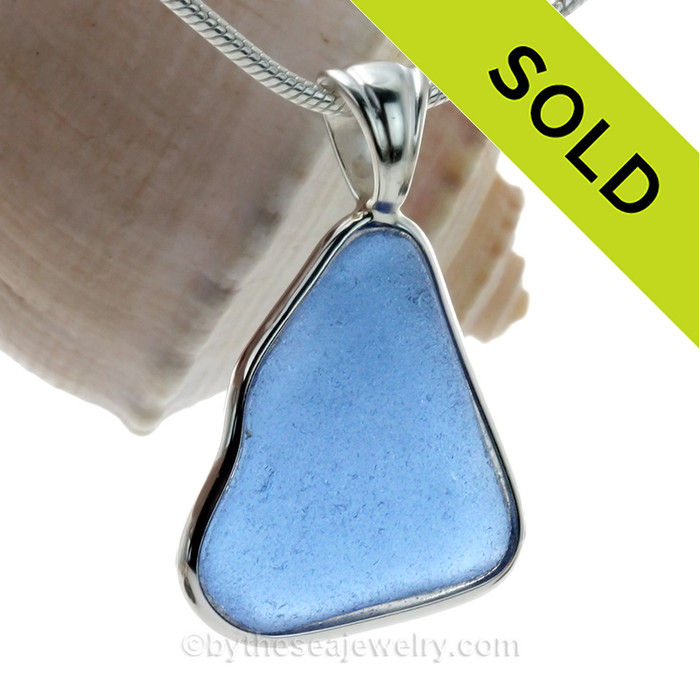 A beautiful bright Carolina Blue Sea Glass set in our Deluxe Wire Bezel© pendant setting in Solid Sterling.
