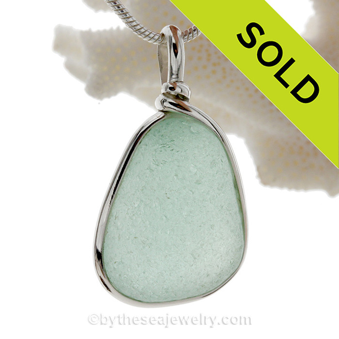 Perfect Thick Seafoam Green Genuine Sea Glass set in our Original Wire Bezel© pendant setting in Sterling Silver.
