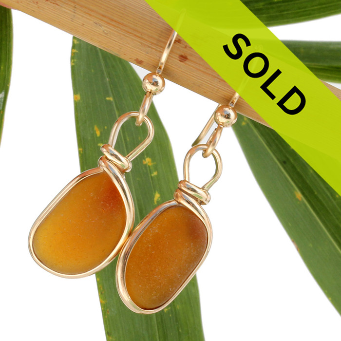 Beautiful bright amber brown sea glass earrings in our Original Wire Bezel© setting in rolled 14K gold. Sorry these earrings have sold