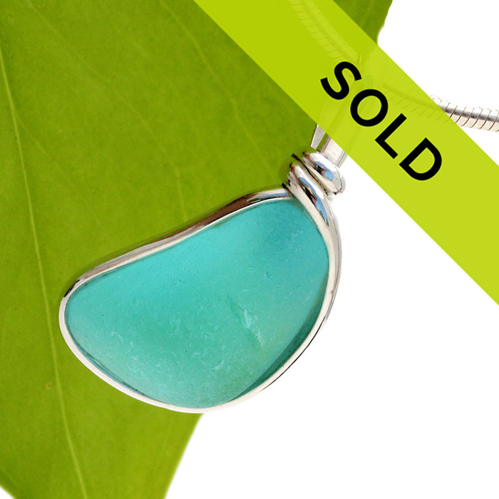 Hard to photograph this STUNNING piece of electric aqua sea glass. It is much prettier in person and GUARANTEED to get you compliments. Sorry this sea glass pendant has sold!
