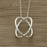 Cross over sphere necklace