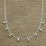 Dangling dot necklace