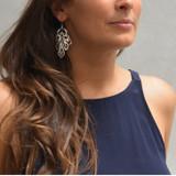 dangling scroll earrings
