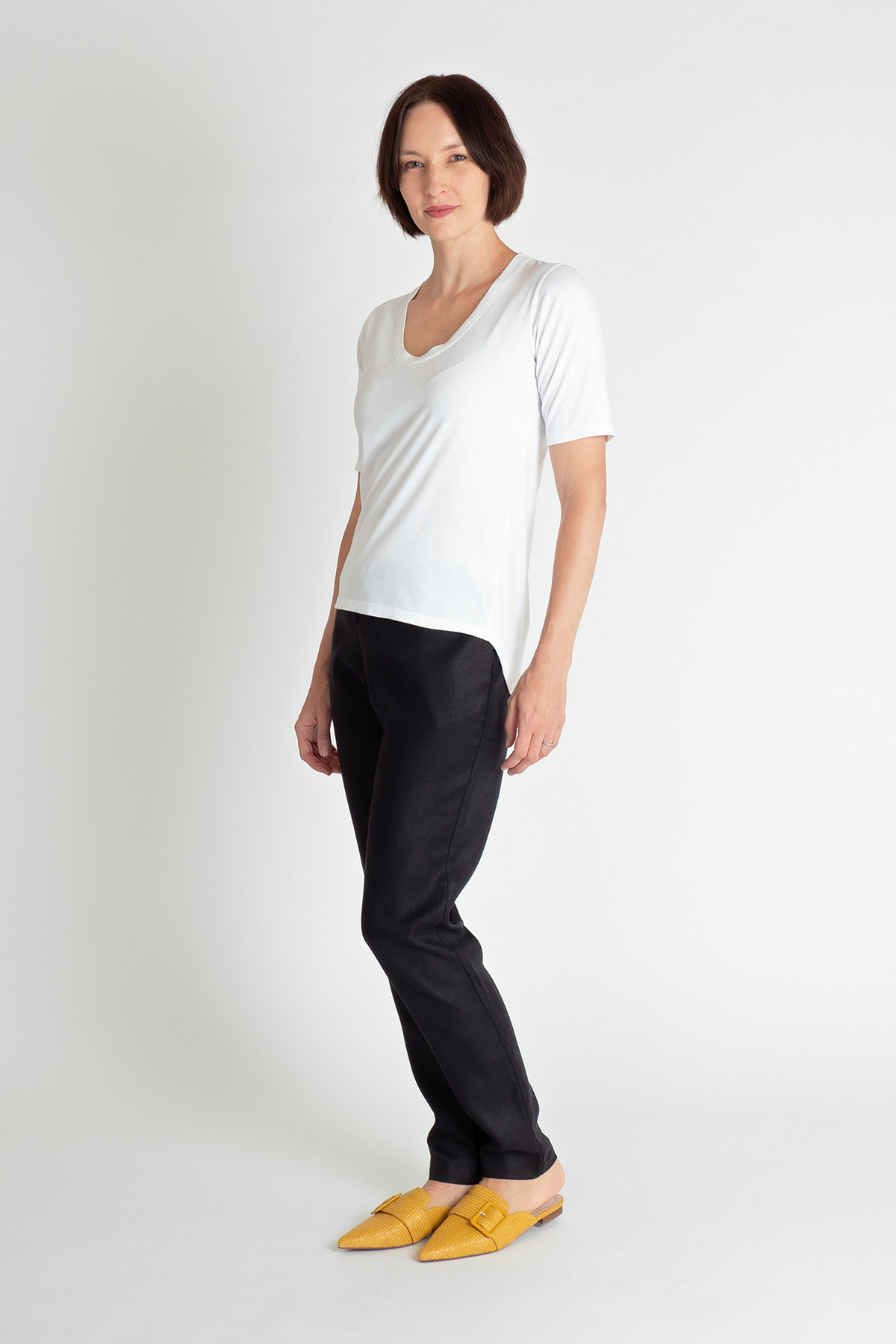 • Premium Australian-woven organic cotton—lightweight and soft-to-touch • Scoop neck • Slim fit • Generous, hemline with additional length at back • Half-length sleeves • Contrast black binding inside collar • Contrast black top stitching • Pre-washed for a lasting, perfect fit • Designed and made ethically in Melbourne, Australia