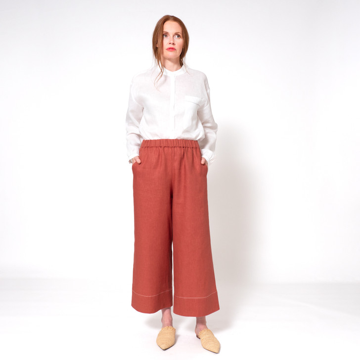 • Premium Japanese linen • Ankle length • High waist, can also be worn on hips • Generous hemline creates an elegant drape • Elasticated waistband • Contrast white top stitching on hem • Angled indented side pockets • Back patch pocket • Designed and made ethically in Melbourne, Australia