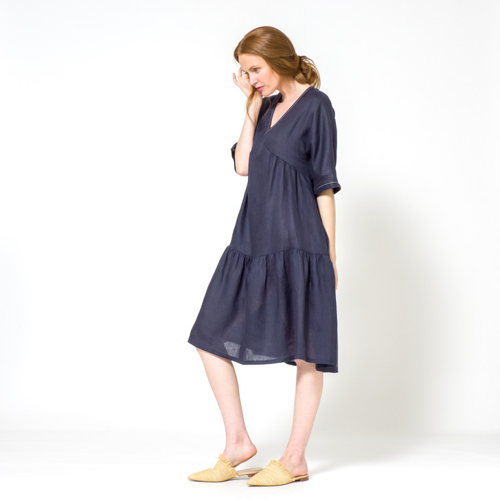 •	Made from light-weight premium Japanese linen (ideal for summer) •	V-neck with signature white top-stitch  •	Slight fabric gather under bust  •	Tapered kimono style ½ sleeves with contrast top-stitch on cuff  •	Below the knee length  •	Back length slightly longer  •	Two ruffle layers at back of dress •	One ruffle layer at front of dress •	Side pockets •	Designed and ethically made in Melbourne, Australia