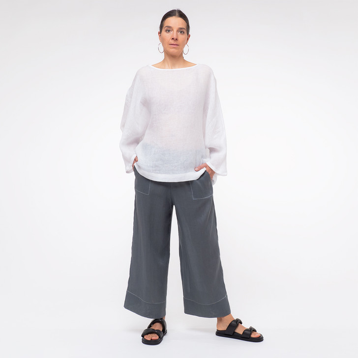 • Oeko-Tex® certified, premium, lightweight Japanese linen • Ankle length, wide leg design • Generous hemline creates an elegant drape • Elasticated waistband • Contrast white top stitching on hem • White top stitched rectangular front patch pockets with angled opening • White top stitched faux back welt pocket • Designed and made ethically in Melbourne, Australia