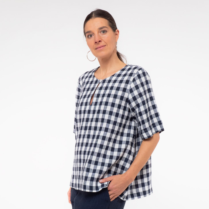 • Premium lightweight Japanese linen for a beautiful drape and wide, body swing • Keyhole neckline with river shell button • Loose half-length sleeve • Relaxed fitting, highly flattering style • Generous asymmetric hemline, with a little extra length at the back