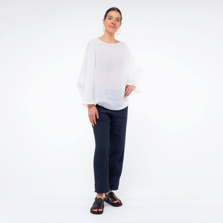 • Oeko-Tex® certified, premium European linen with a high twist texture • Ankle length, tapered leg pant • Indented side pockets • Flat waistband at front, with 5cm elasticated back • Back faux welt pocket with white top stitch