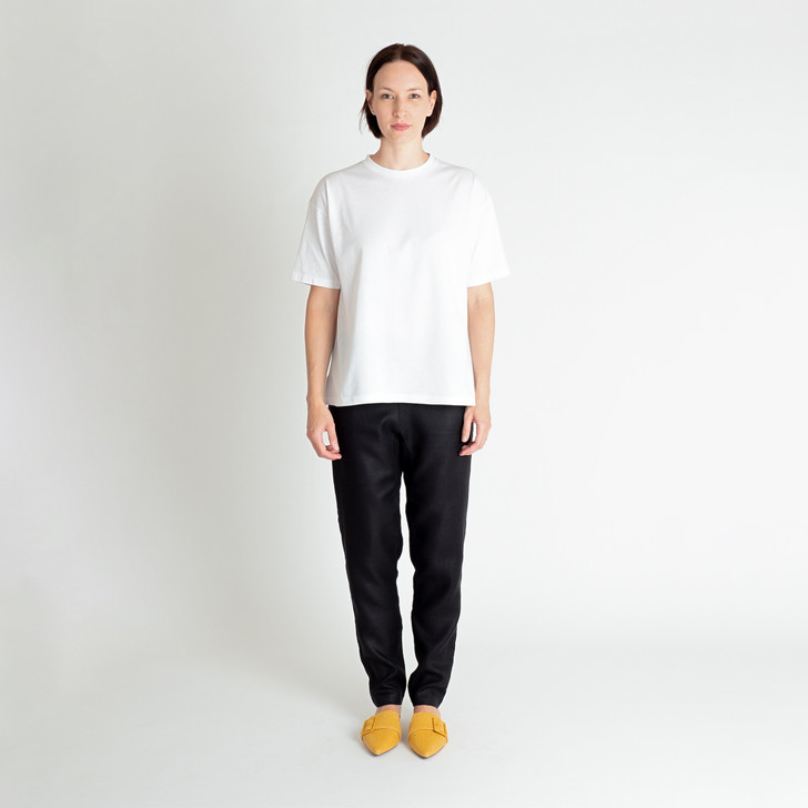 • Premium Australian-woven organic cotton—lightweight and soft-to-touch • Crew neck • Wide, loose fit with generous hemline • Drop shoulders with half-length sleeves • Contrast black binding inside collar • Contrast black top stitching • Designed and made ethically in Melbourne, Australia
