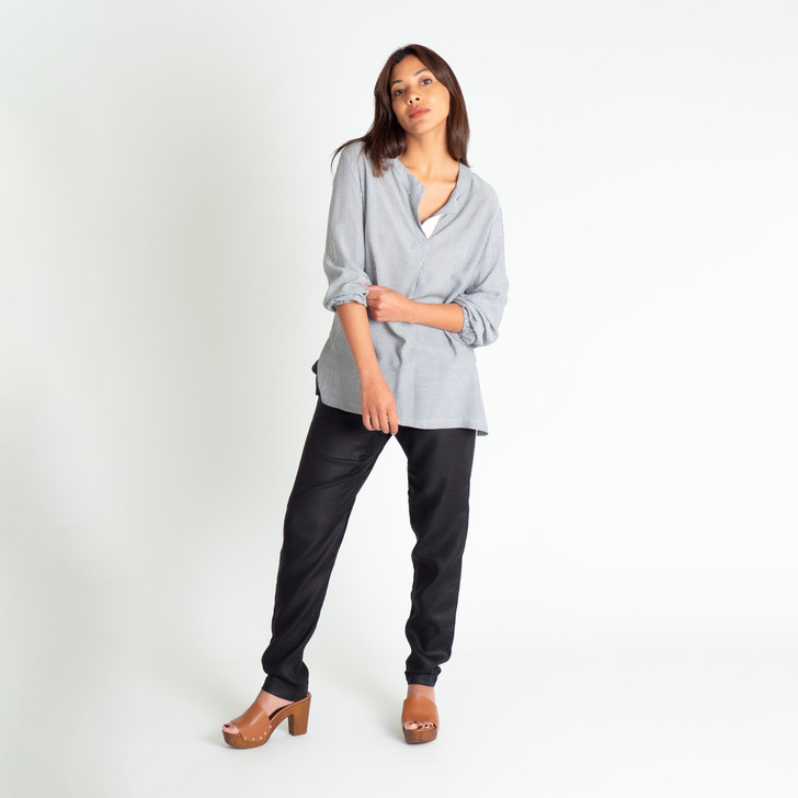• Silky soft, breathable rayon • Buttonless henley collar with herringbone ribbon detail  • Full length sleeves with elasticised cuffs that gather delicately at the wrist • Loose, generous, comfortable fit • Wear it draped over pants or jeans, or tucked in • Designed and made ethically in Melbourne, Australia