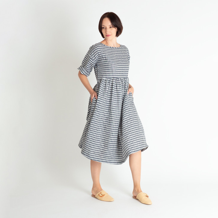 • Premium mid-weight Japanese linen with a small navy and white check • Gathered waist and below-the-knee coverage • Kimono style, 3/4-length sleeves • Bodice sits slightly above the waist for a comfortable fit. • Signature side inseam pockets • 3cm hemline ensures dress can be let down or taken up if needed • Designed and made ethically in Melbourne