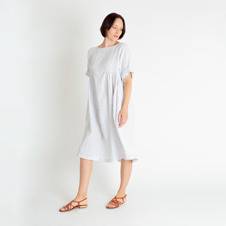 • Premium, mid-weight French linen • Diagonally angled front and back side gathers under the bust with black top stitch • Scoop neckline • Elbow-length sleeves with 4cm cuff • Inset side pockets • Over the knee length with 3cm hem • Designed and made ethically in Melbourne, Australia