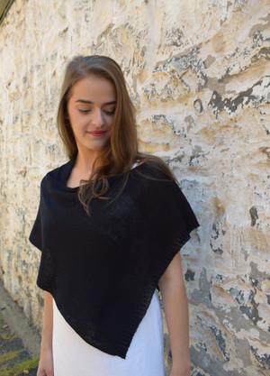 Petite poncho, black - worn with seam at shoulder