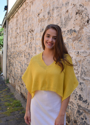Petite poncho, mango - worn with seam at front