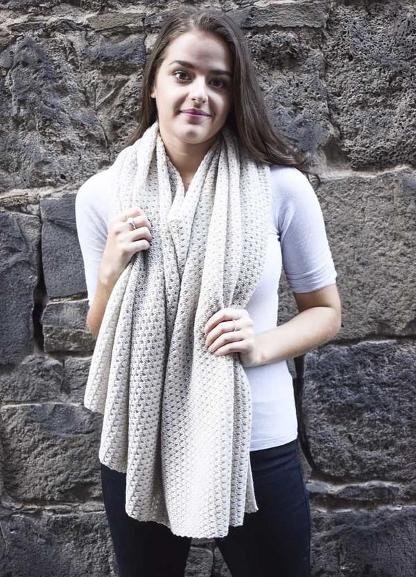poncho worn as a chunky scarf