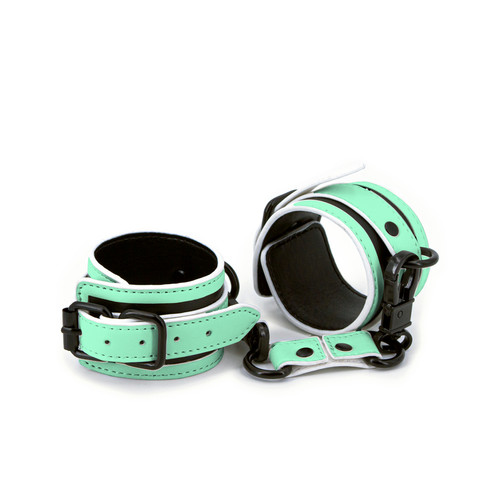 Buy the GLO Glow-In-The-Dark Adjustable Faux Leather Wrist Cuffs with connector - NS Novelties