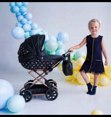 Invictus Baby Designer style Print Dolls pram in Black and rose gold