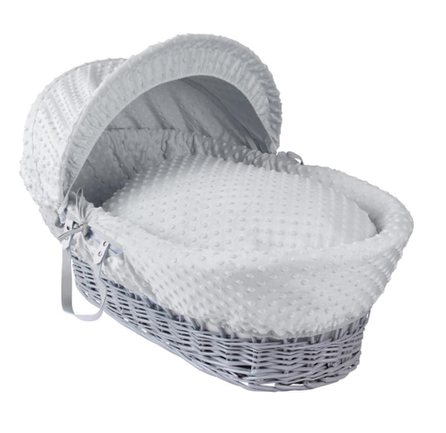 grey wicker moses basket with grey bedding