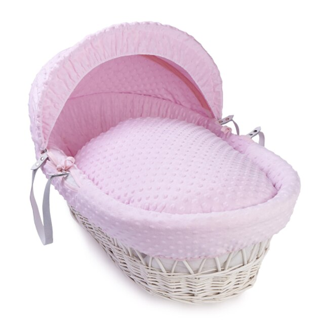 white wicker moses basket pink bedding