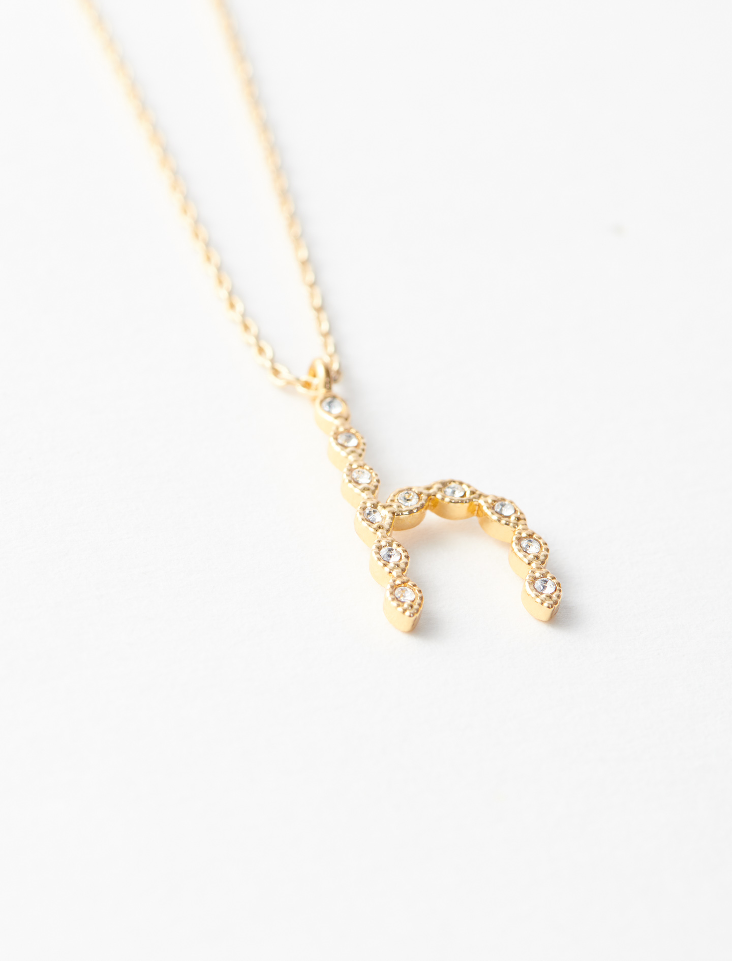 Rhinestone H necklace - Gold