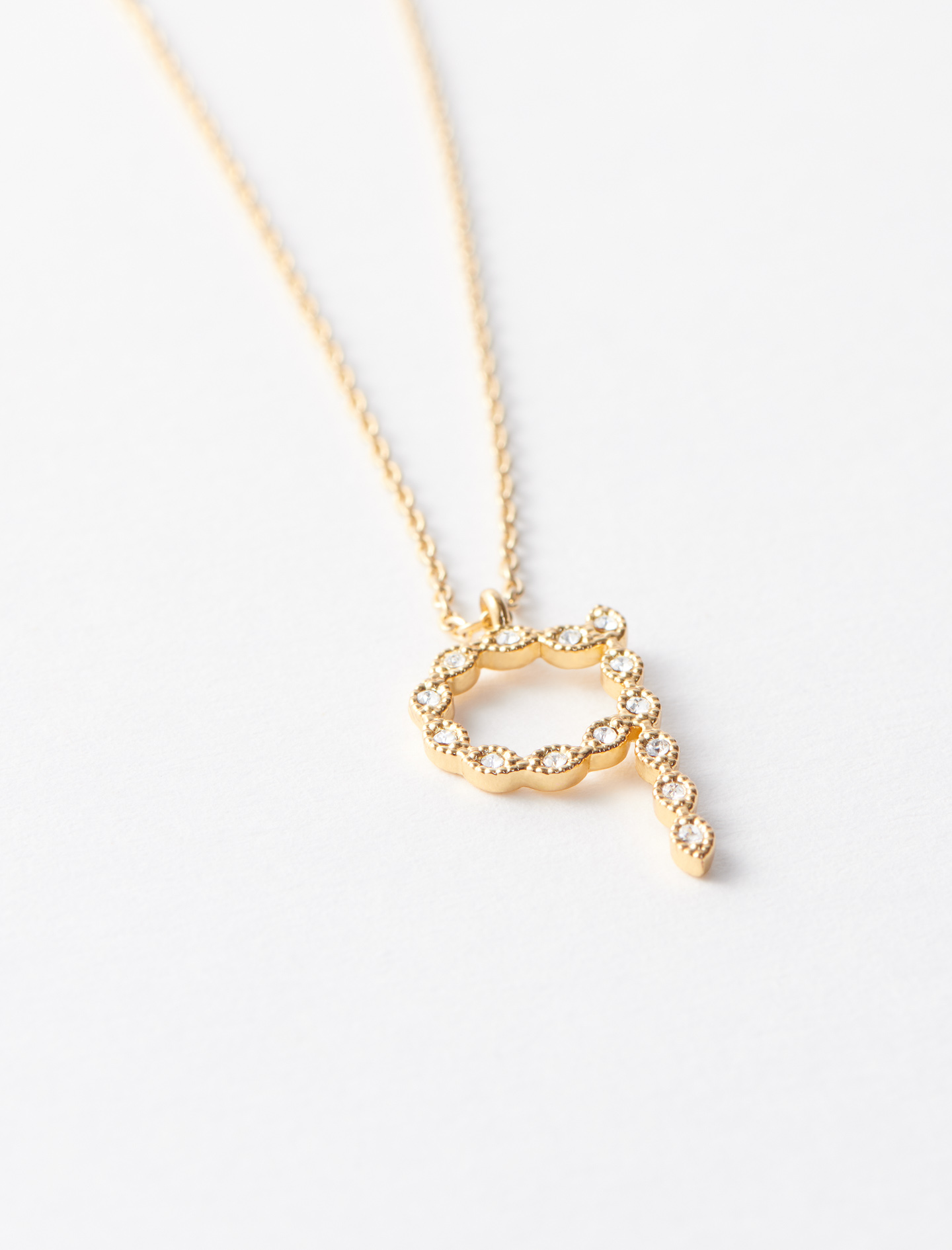 Rhinestone Q necklace - Gold