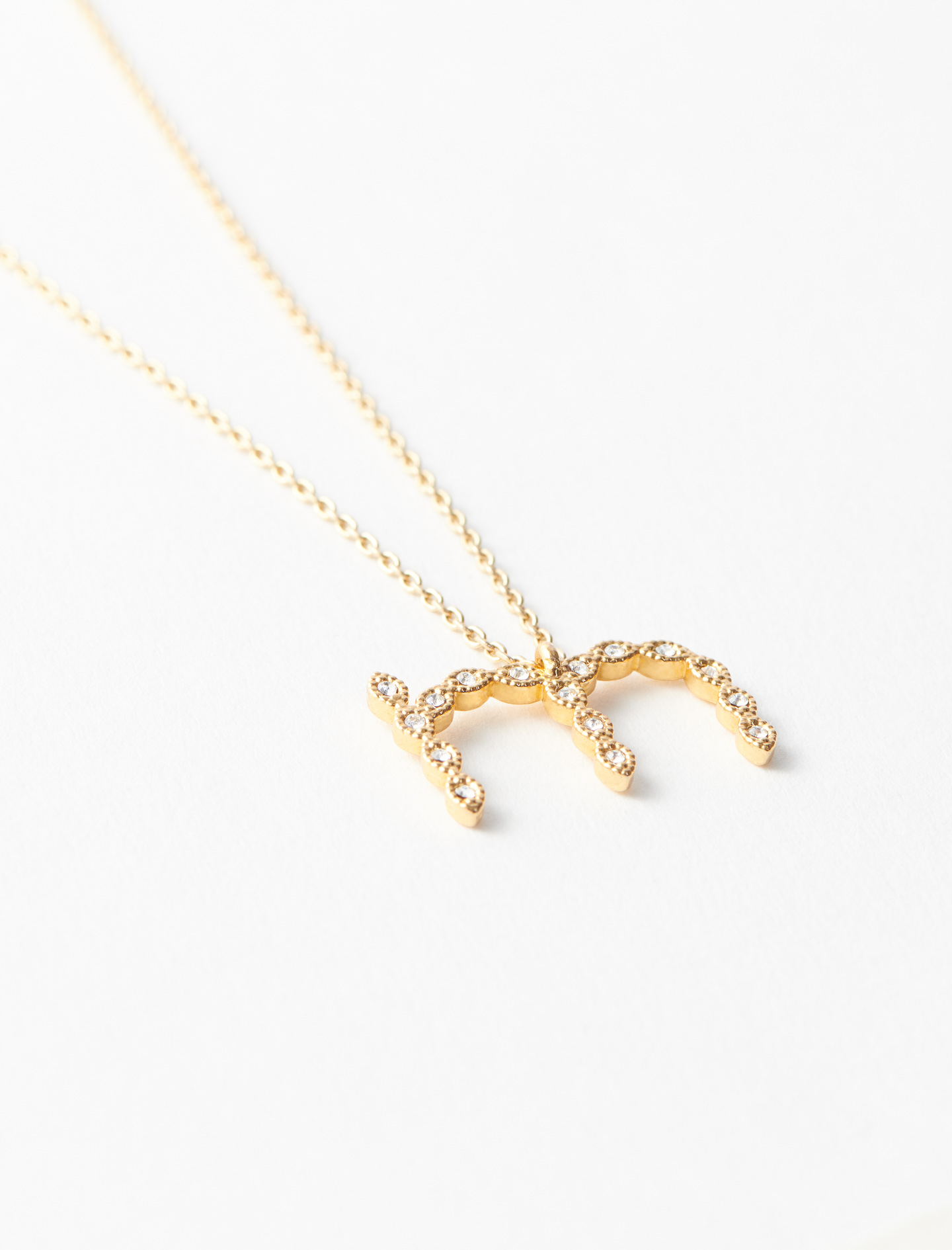 Rhinestone M necklace - Gold