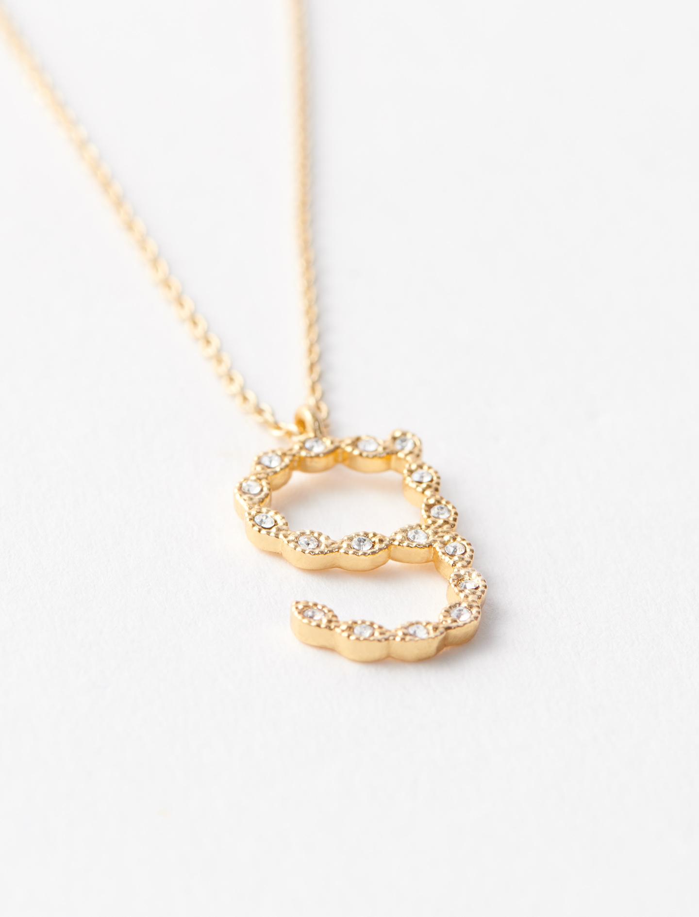 Rhinestone G necklace - Gold