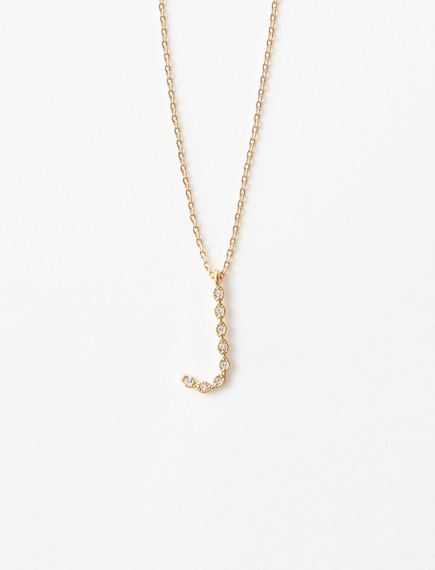 Rhinestone J necklace - Gold