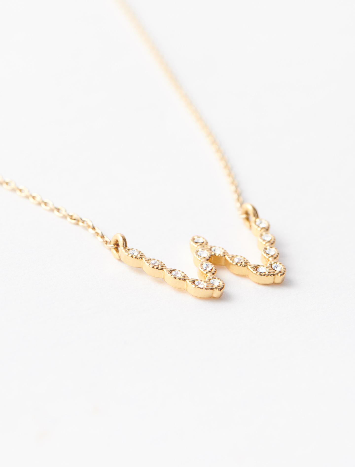 Rhinestone W necklace - Gold
