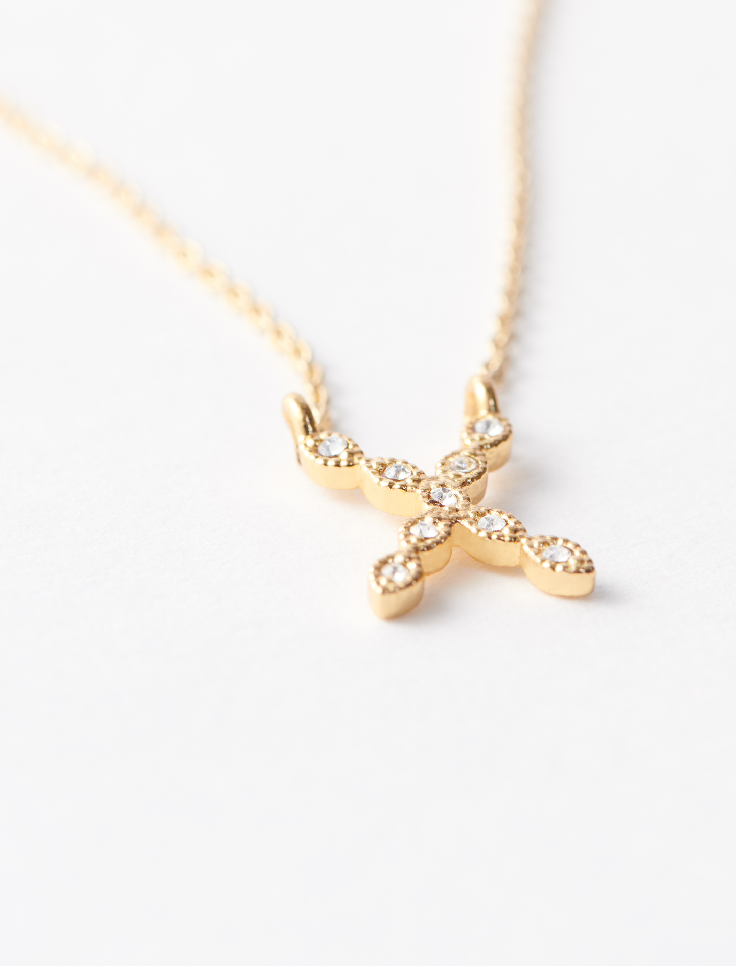 Rhinestone X necklace - Gold
