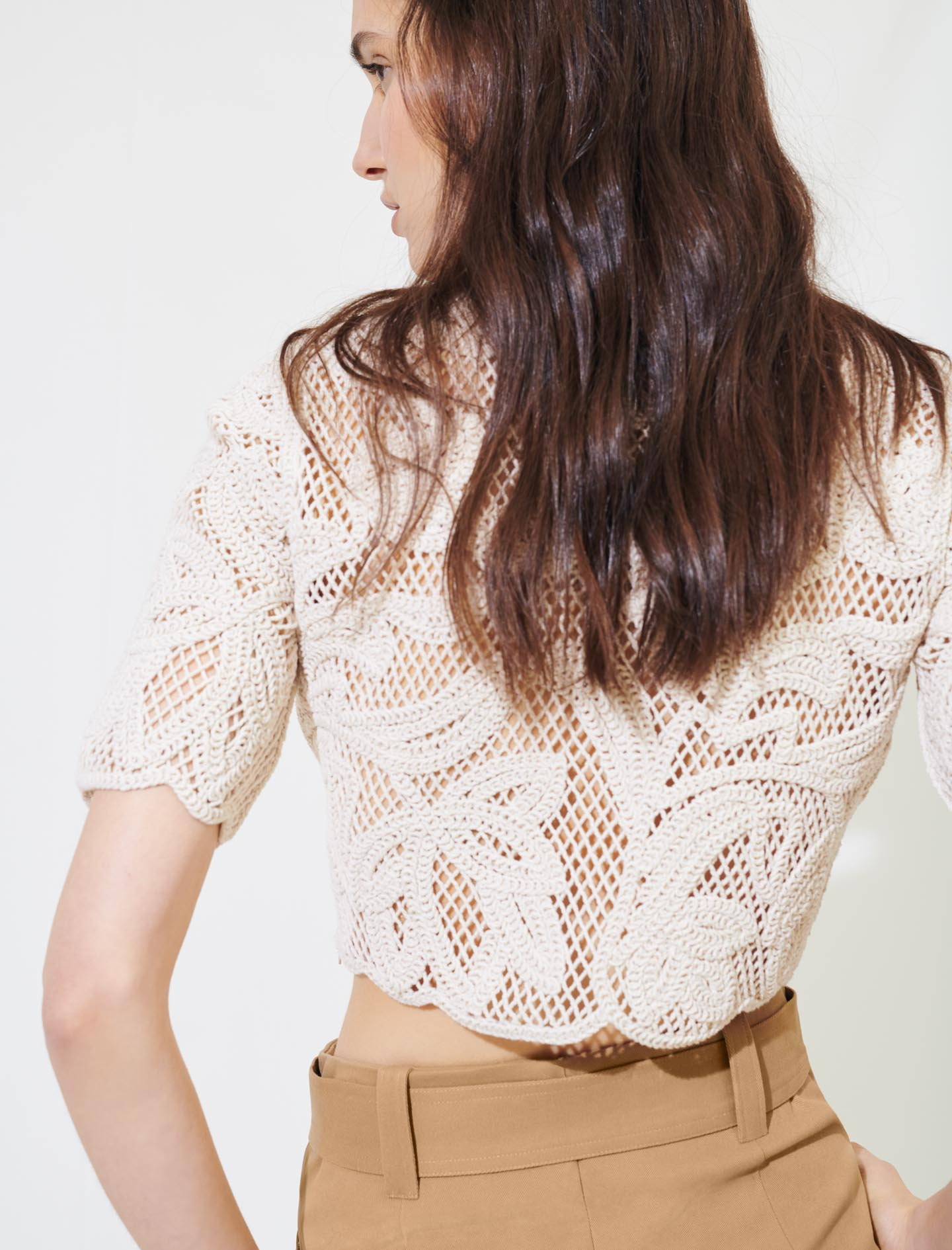 Crochet top with short sleeves in beige by Maje Paris