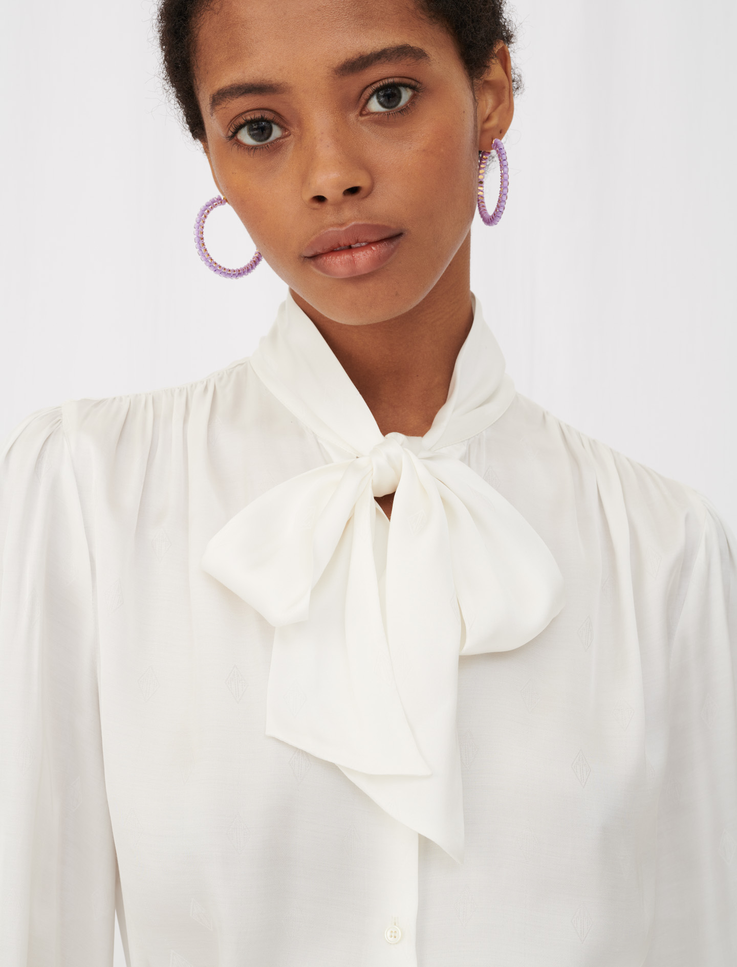 Women's white shirt with bow neckline and long sleeves by Maje Paris