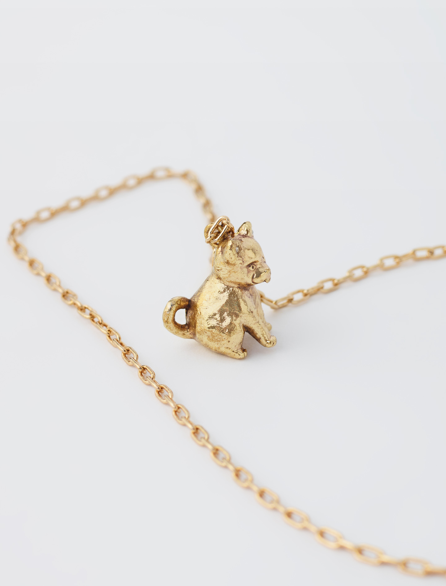 Gold necklace with dog by maje paris