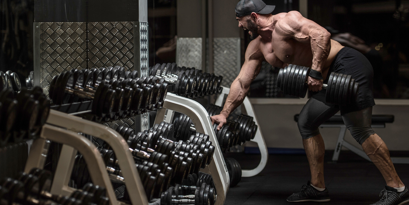 Man Lifting Heavy Weights in Gym