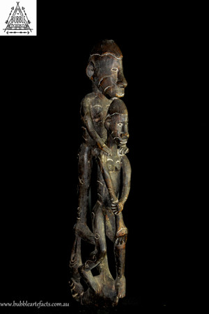 Exquisite Asmat Ancestor Figures (Male and Female), Casuarina Coast, West Papua