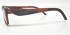 Side view of brown reading glasses