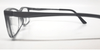 Side view of black reading glasses