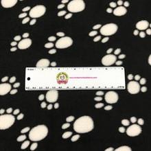 White Paw Prints on Black Fleece - 1/2 yard