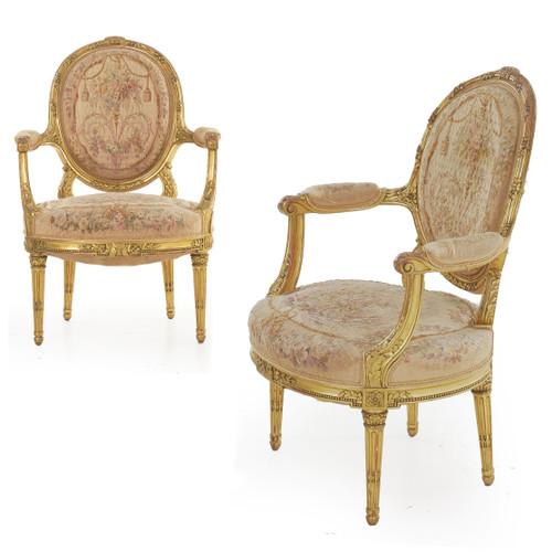 Pair of Louis XVI Style Giltwood Arm Chairs | Paris, circa 1900