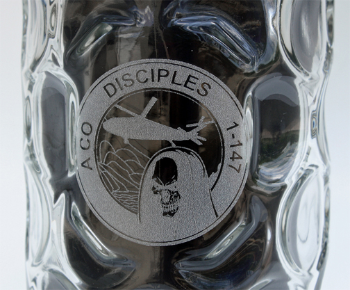 Custom logo engraving on dimpled glass mug