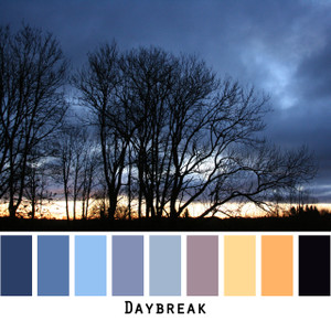 Daybreak - indigo ink navy blue sunrise gold with black trees, colors for blondes, brunettes, black grey hair, blue eyes, photo by Inese Iris Liepina, Wrapture by Inese